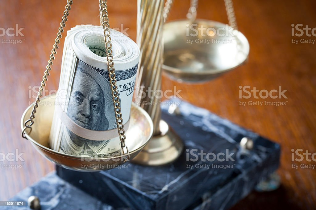 Scales of Justice with Money stock photo