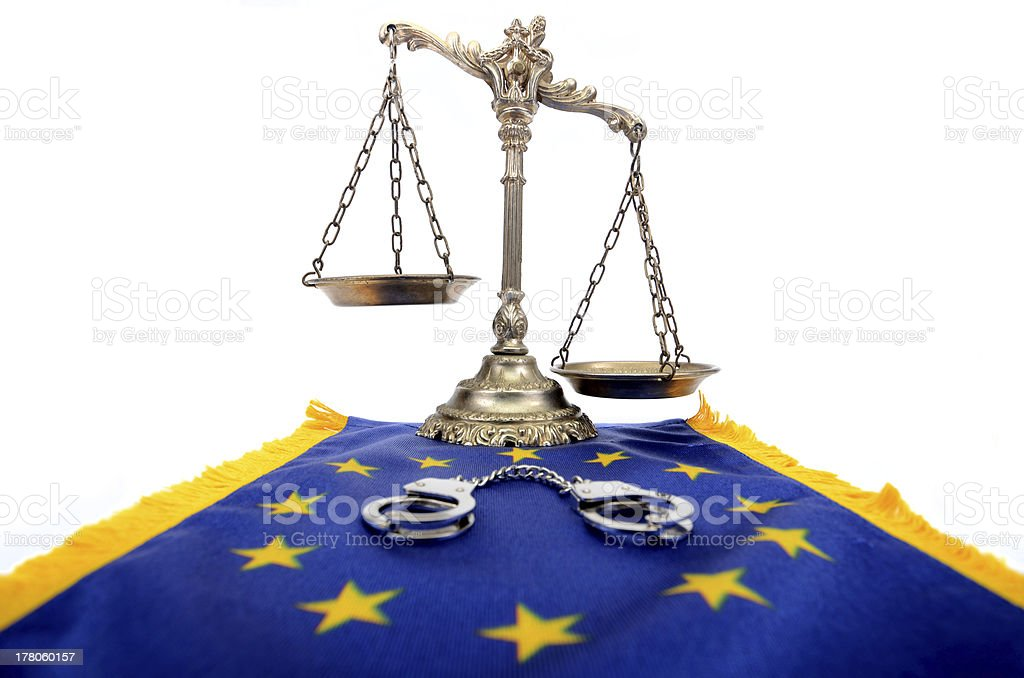 Scales of Justice,European Union flag and handcuffs royalty-free stock photo