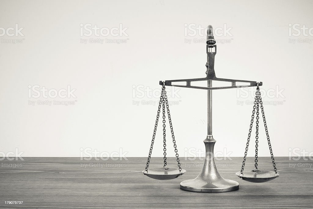 Scales on a table. Vintage sepia photo stock photo
