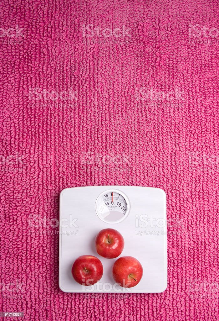 Scales three apples stock photo