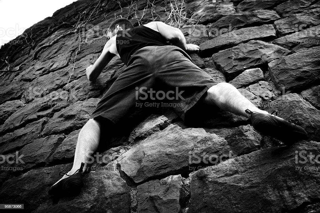 scaling the wall royalty-free stock photo