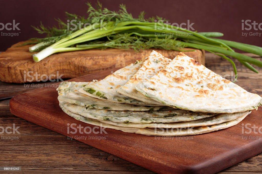 Scallion pancakes. Round unleavened flatbread minced green onion stock photo