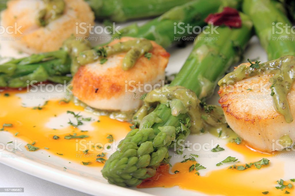 scallops with green asparagus royalty-free stock photo