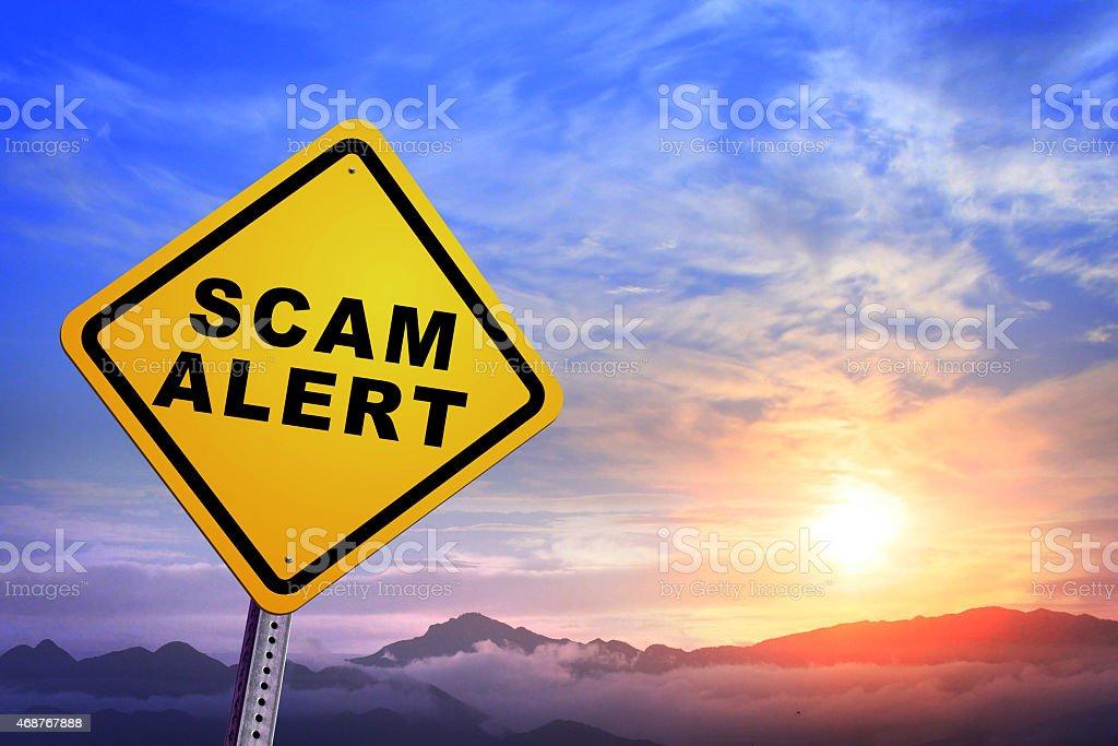 scam alert stock photo