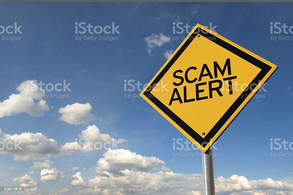 Scam alert yellow highway road sign stock photo