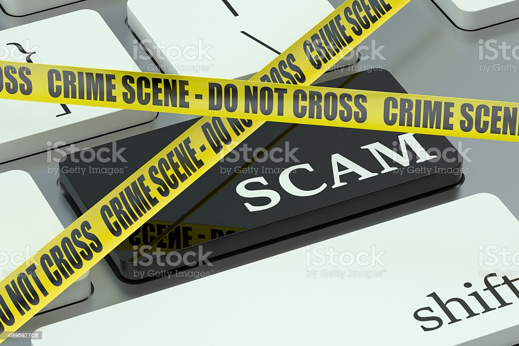 scam concept on the computer keyboard stock photo