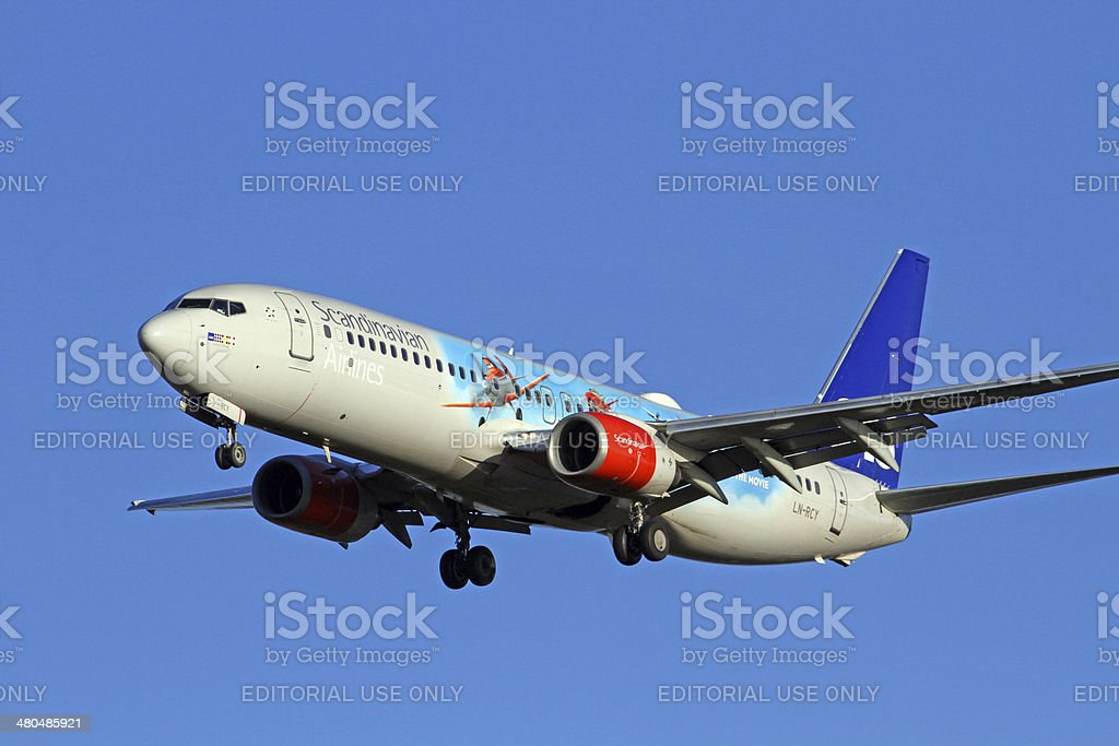 Scandinavian Airlines System Boeing 737-800 landing at Manchester Airport. stock photo