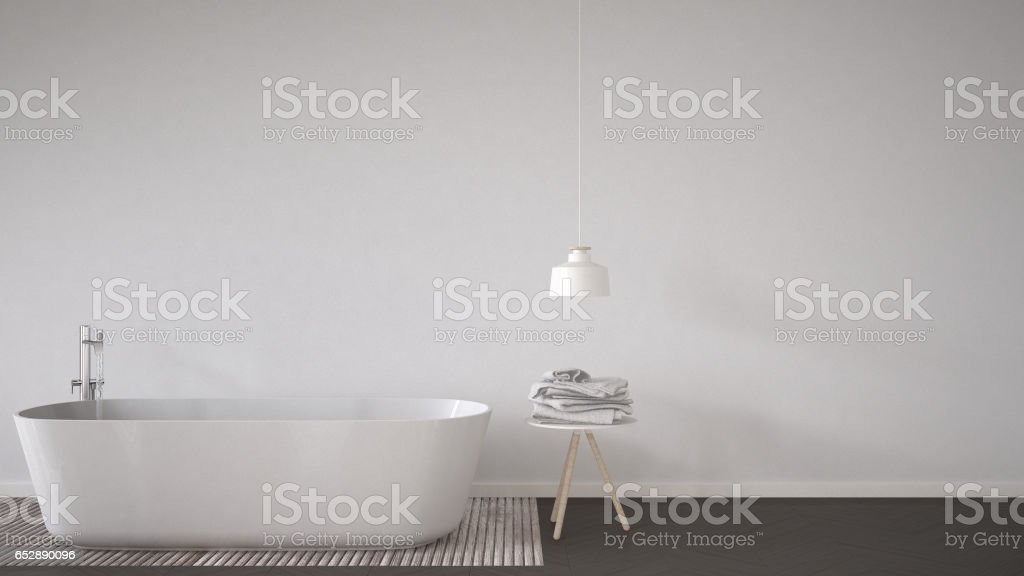 Scandinavian bathroom background, bathtub, table and lamp on herringbone natural parquet flooring, interior design stock photo