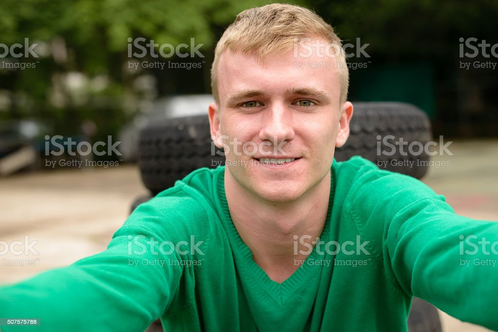 Scandinavian man outdoors taking selfie stock photo