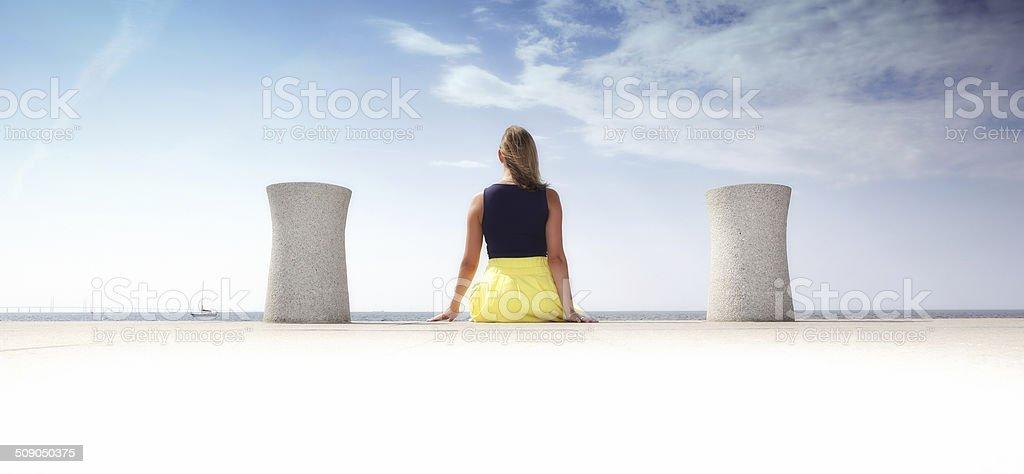 Scandinavian woman sits on dockside stock photo
