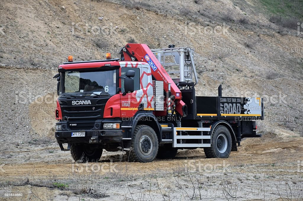 Scania P360 (4X4) driving on the unmade road stock photo