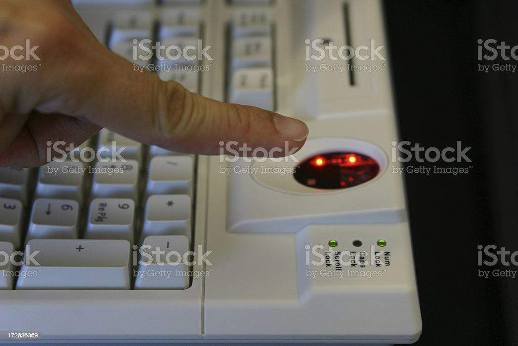 scaning the index on a biometric keyboard royalty-free stock photo