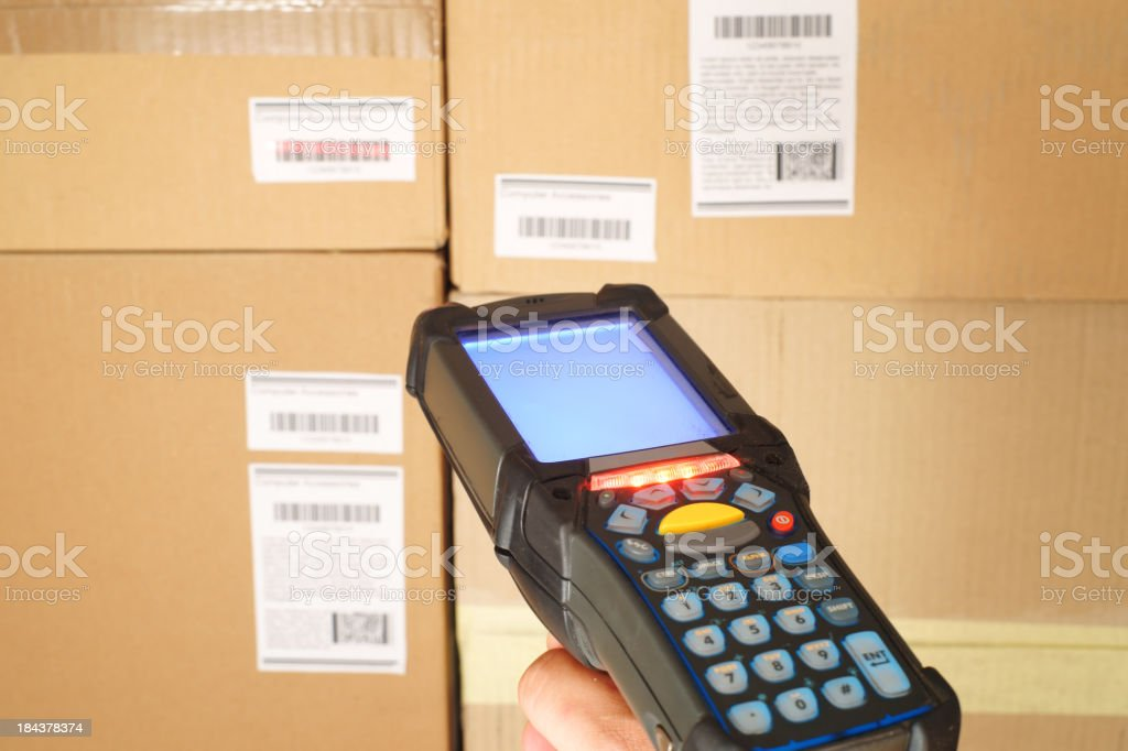 Scanning bar codes in warehouse stock photo