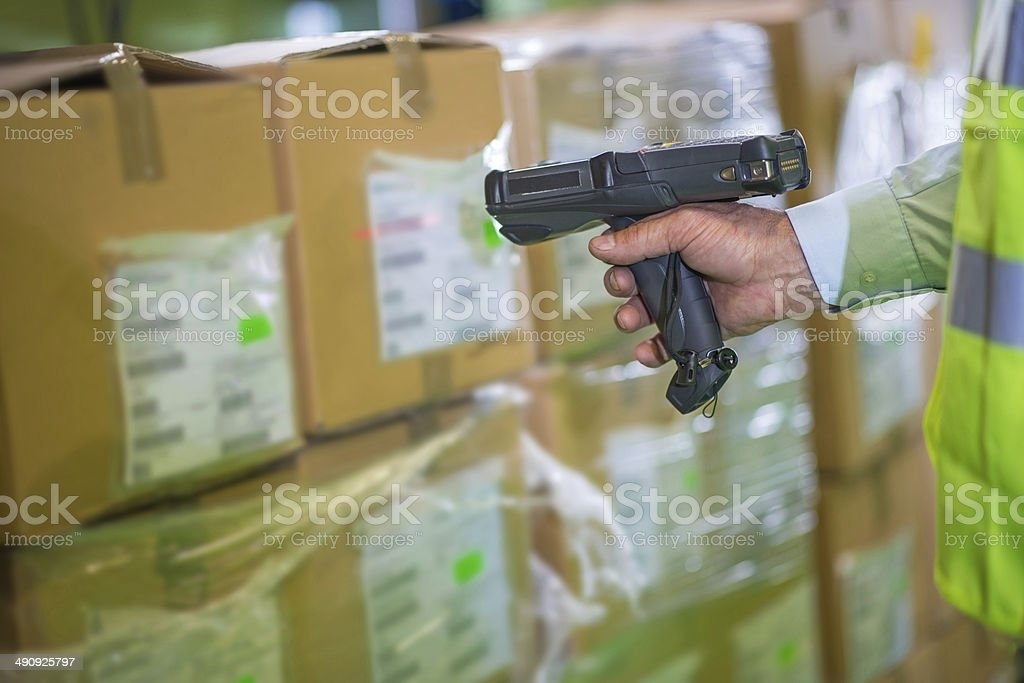 Scanning Boxes In The Warehouse stock photo