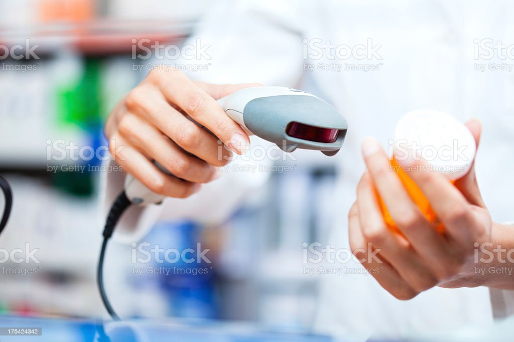 Scanning medicine with barcode reader at the pharmacy stock photo
