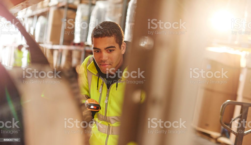 scanning pallets in the warehouse stock photo