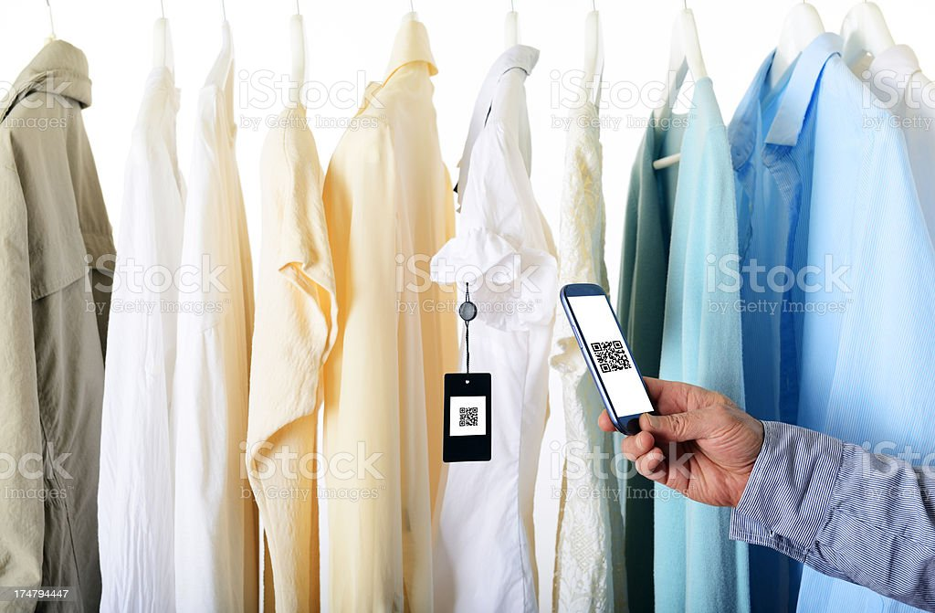 Scanning QR Code inside Shopping Mall royalty-free stock photo