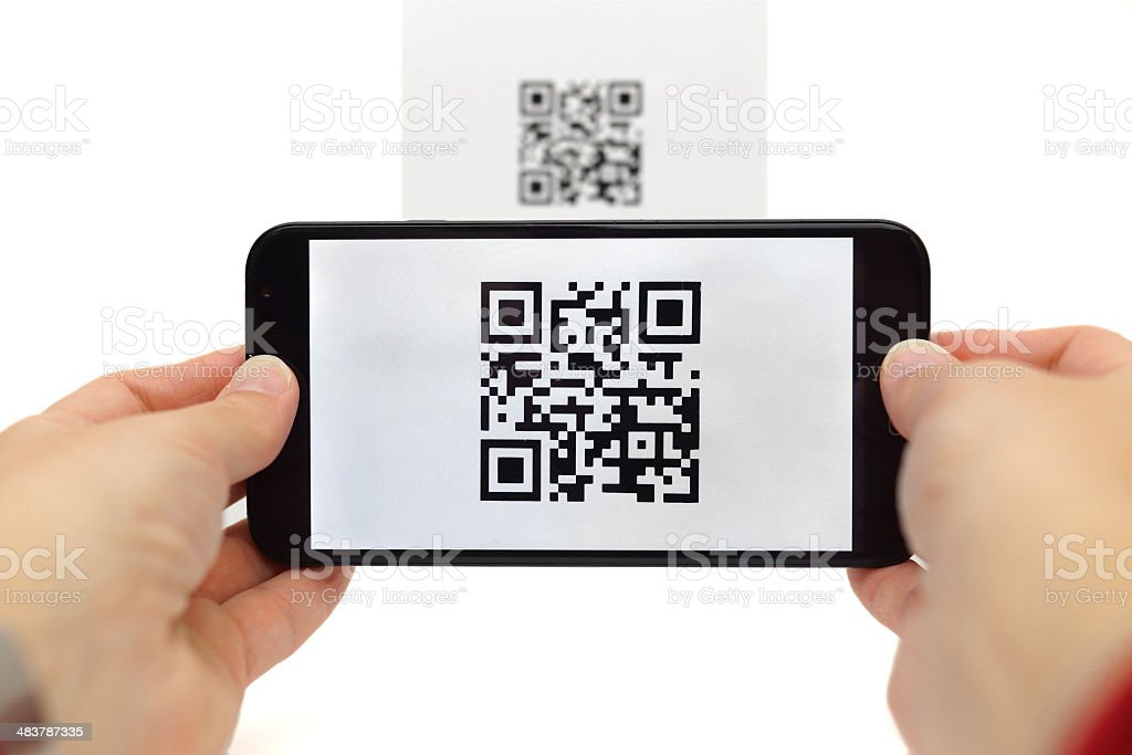 Scanning QR code with mobile smart phone stock photo