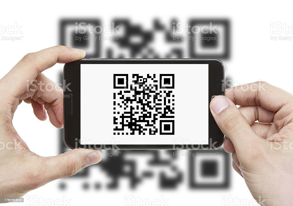 Scanning QR code with smart phone stock photo