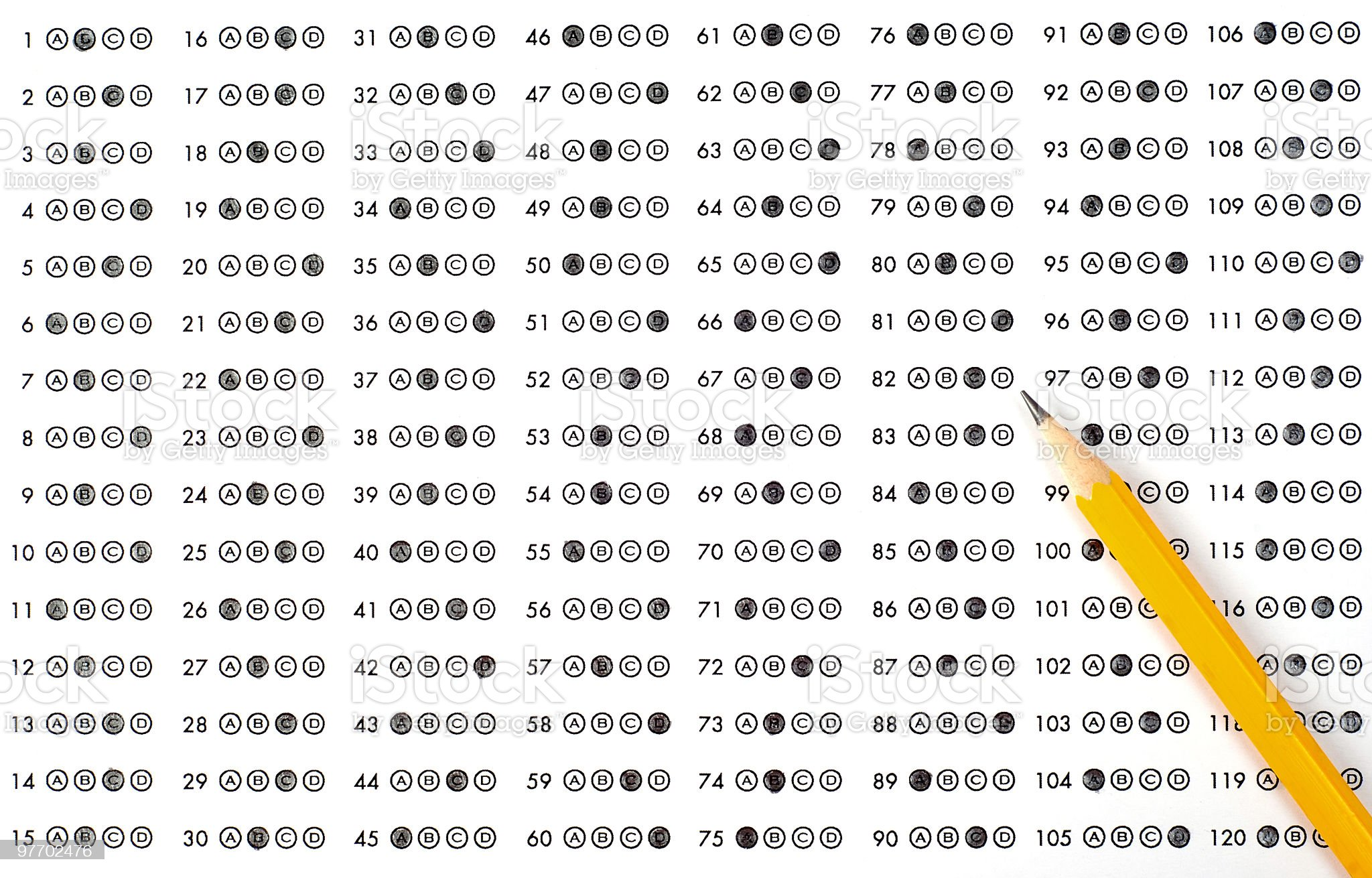 A scantron answer sheet with a pencil and bubbled answers royalty-free stock photo
