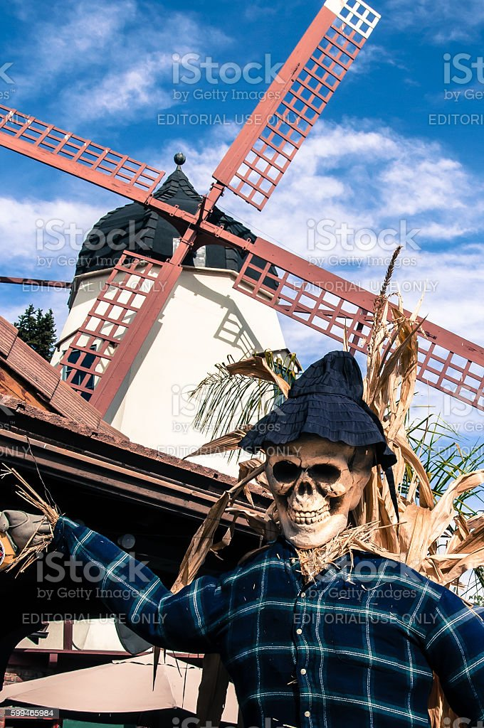 Scarecrow and WIndmill stock photo