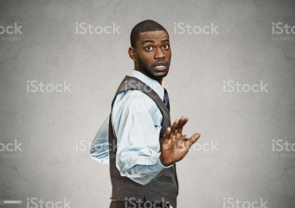 Scared business man being followed stock photo