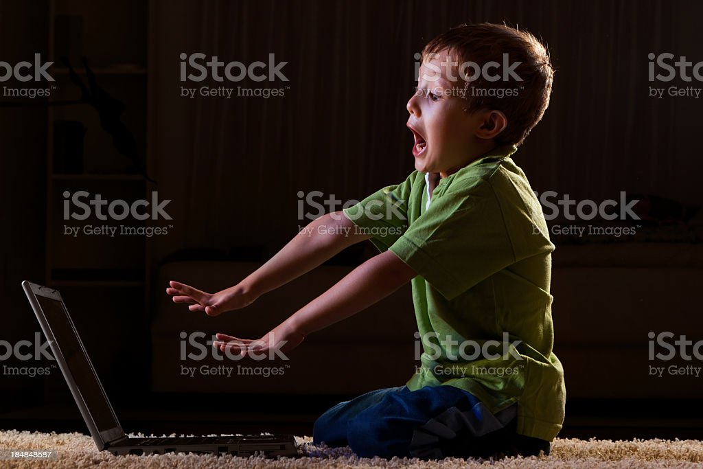 Scared child in front of the laptop royalty-free stock photo