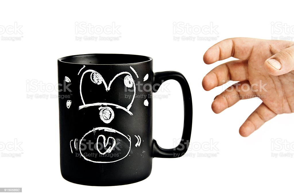 scared cup and a hand stock photo