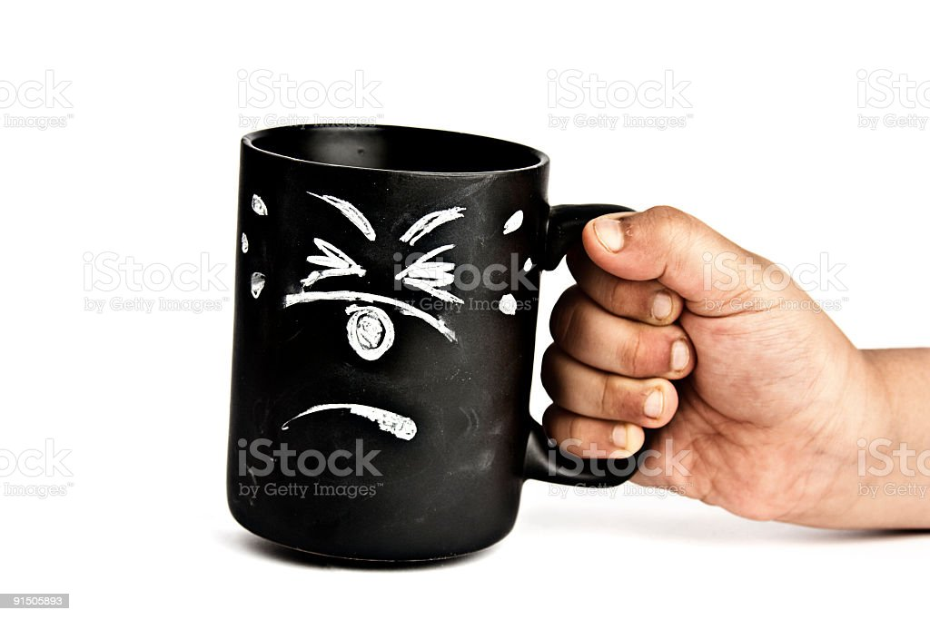scared cup held by a hand stock photo