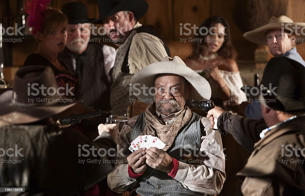 Scared Gambler with Guns in His Face stock photo