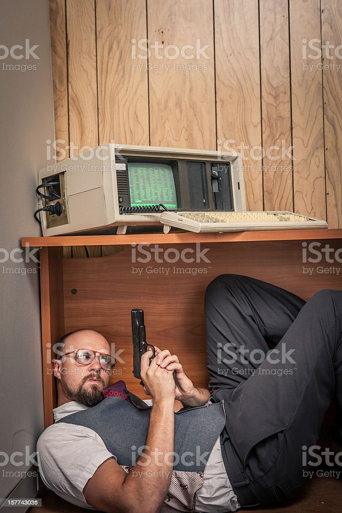 scared gun weilding office worker 1980's computer style royalty-free stock photo