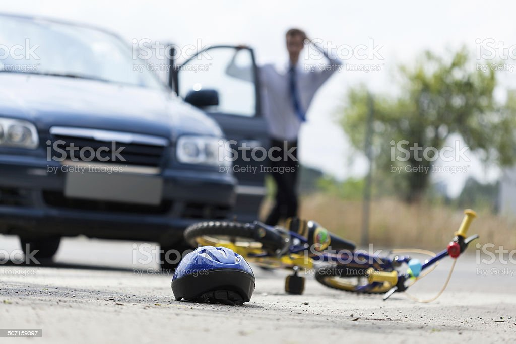 Scared man after hittng child stock photo
