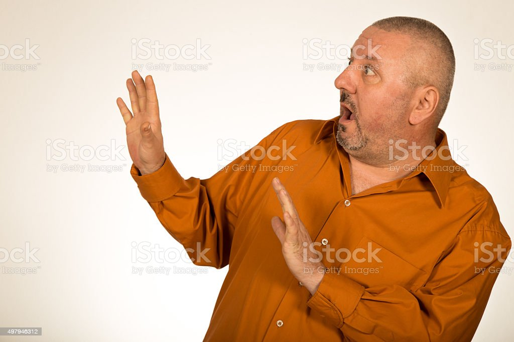 Scared overweight businessman isolated on white stock photo