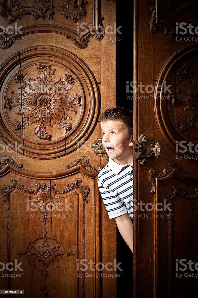 Scared Pre-Adolescent Child peeping royalty-free stock photo