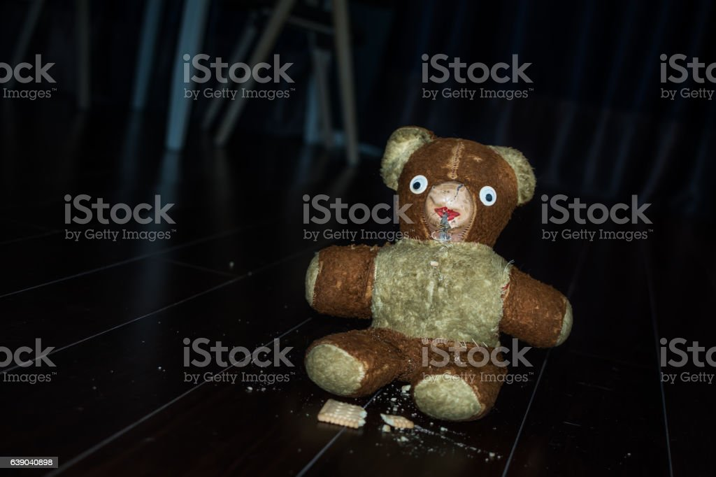 Scared teddy bear with stolen cookie. stock photo