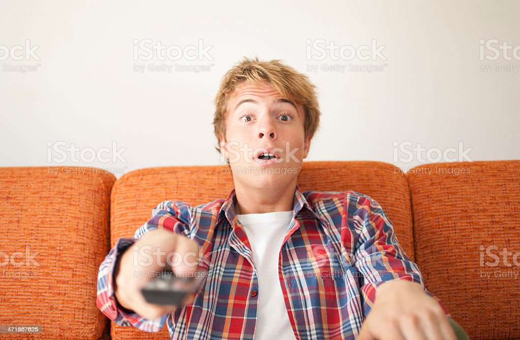 scared teenager watching tv royalty-free stock photo