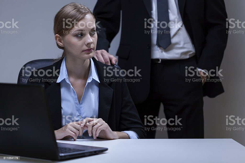 Scared woman and self-confident boss stock photo