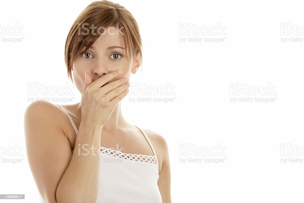 Scared woman covering mouth with hand stock photo