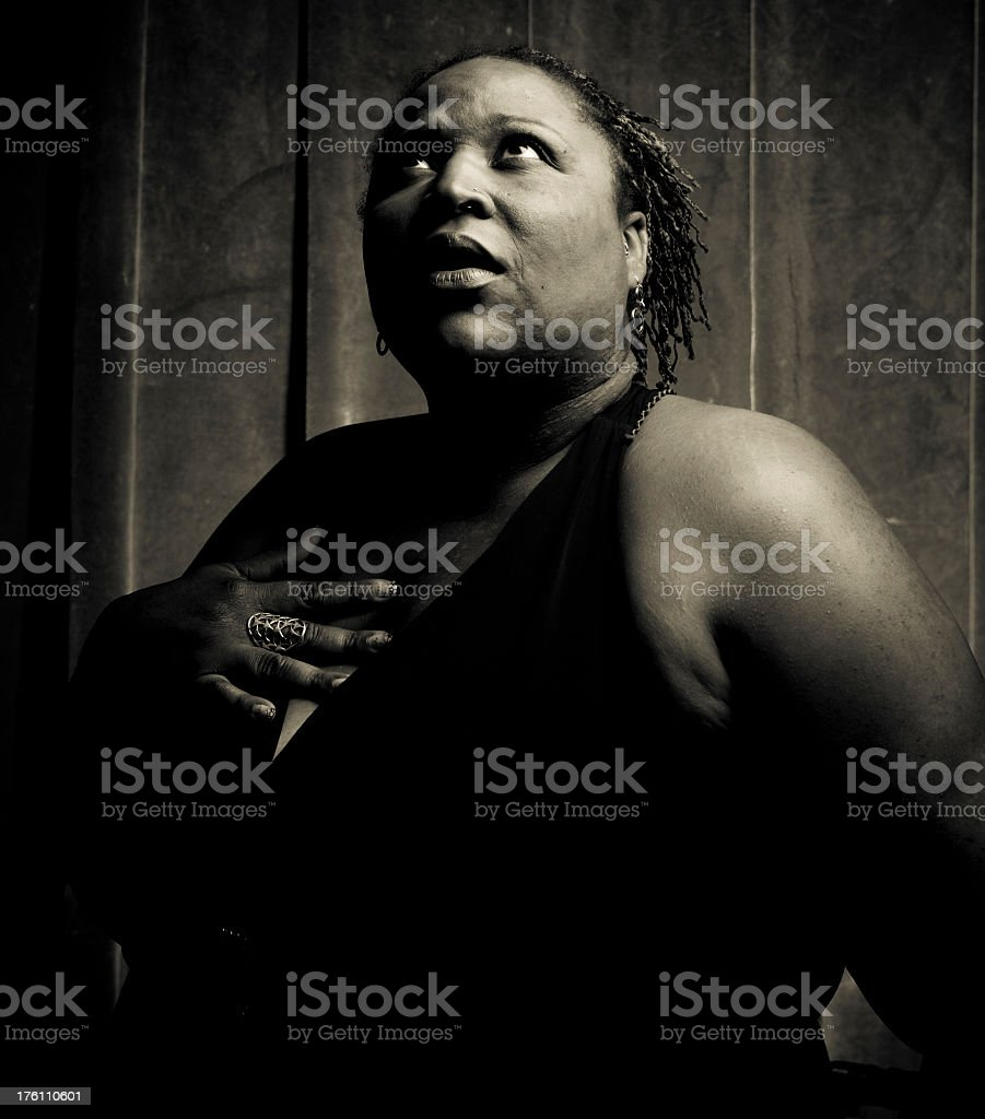 Scared Woman in Black stock photo