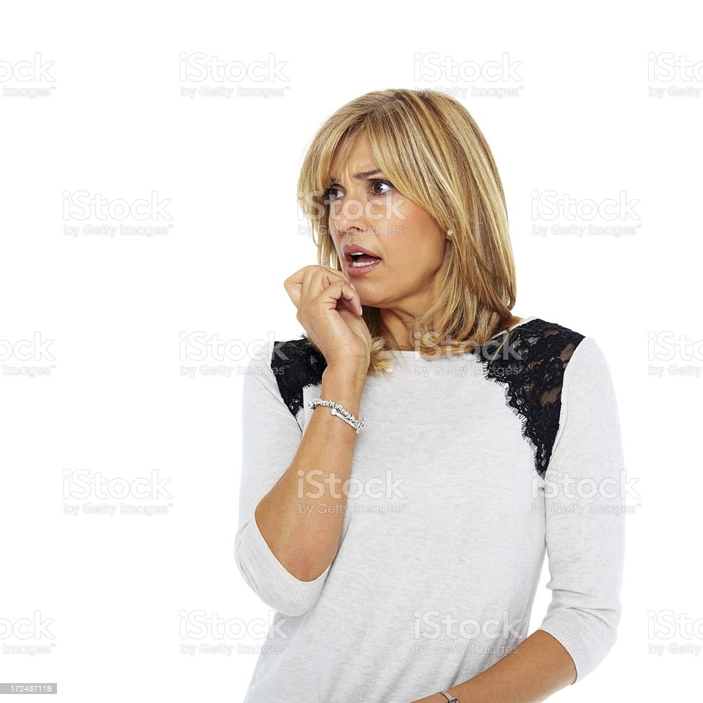 Scared woman looking at copyspace over white royalty-free stock photo