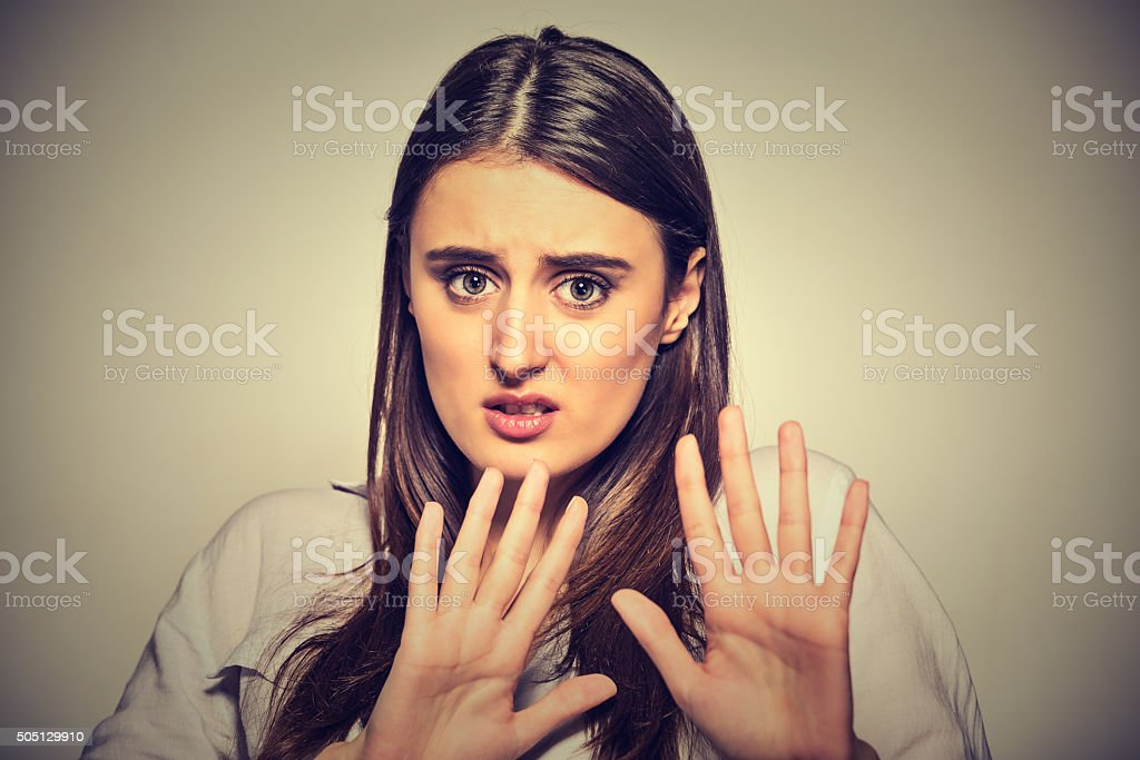 scared woman raising hands up in defense afraid stock photo