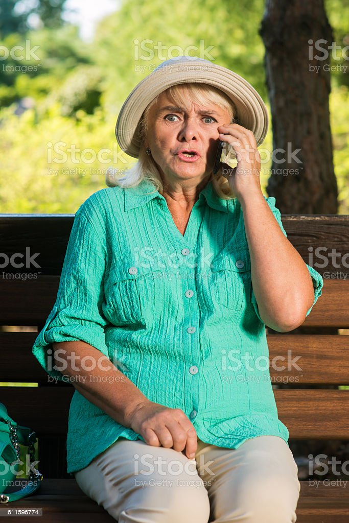Scared woman with a phone. stock photo
