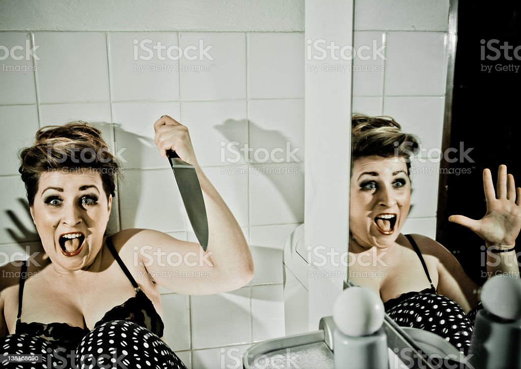Scared woman with knife stock photo