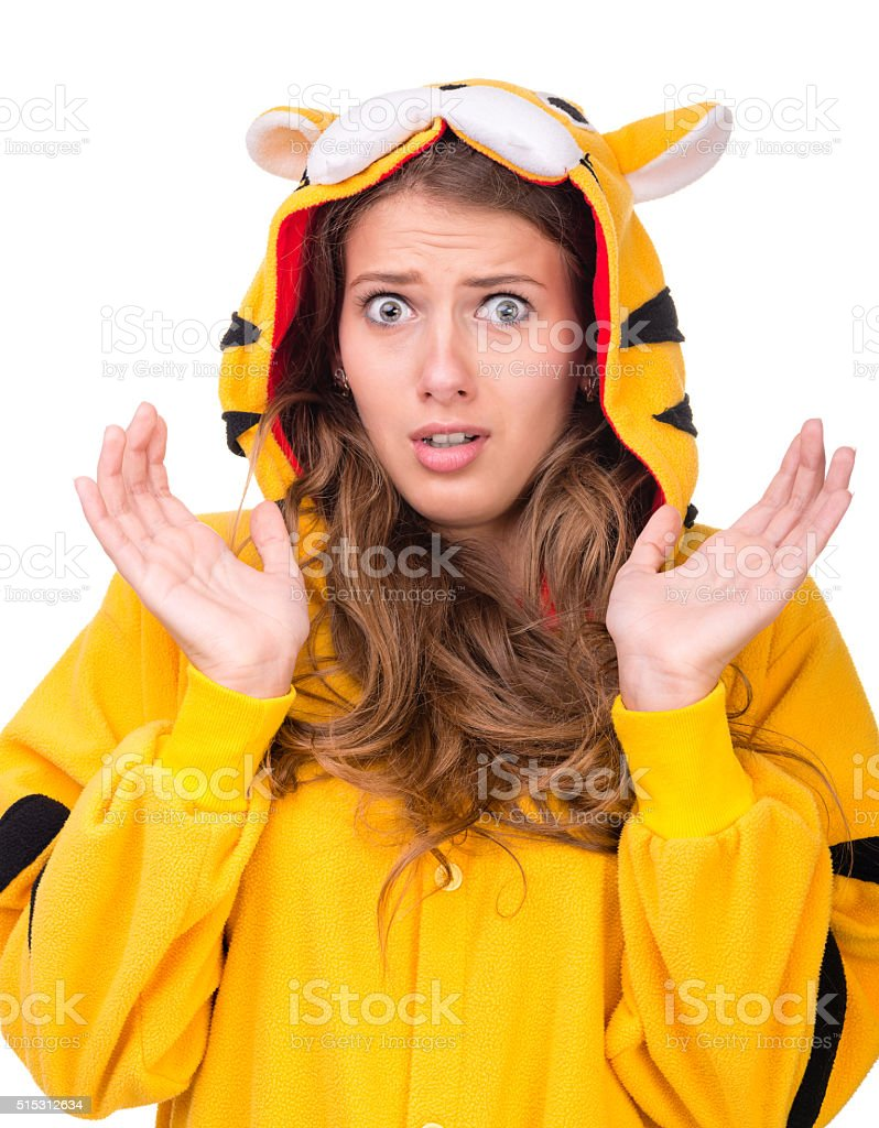 scared young woman dressed as a tiger stock photo