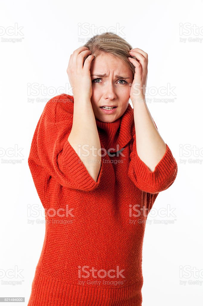 scared young woman protecting herself against violence and danger stock photo