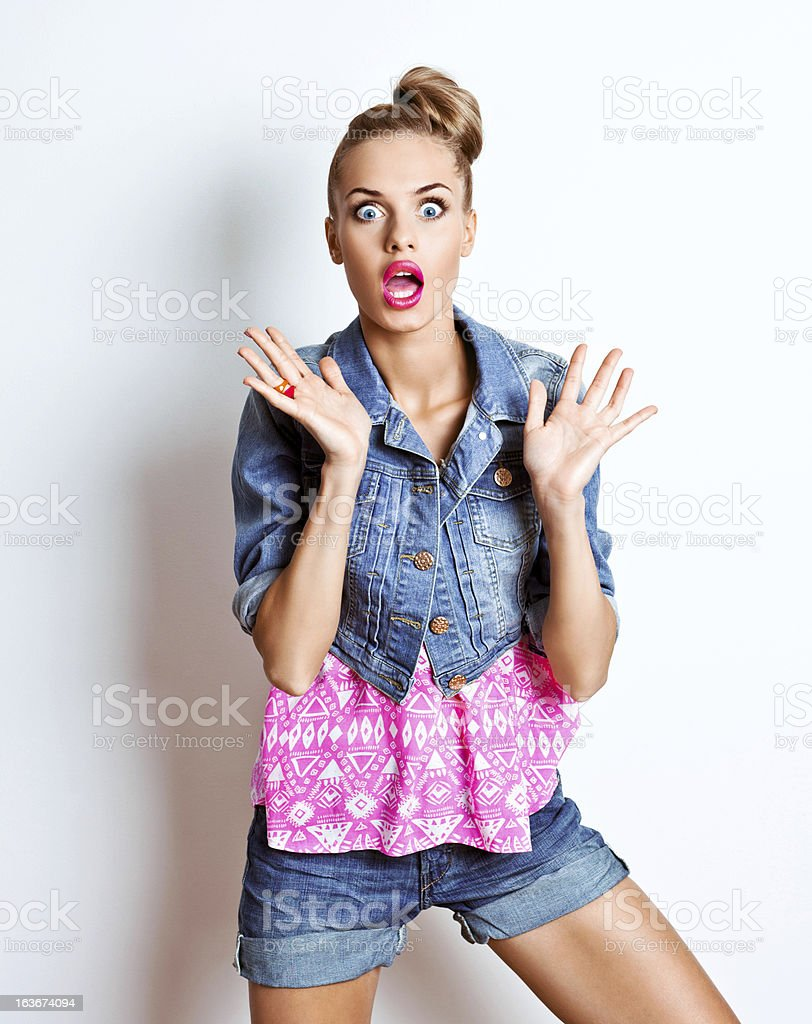 Scared young woman, Studio Portrait royalty-free stock photo
