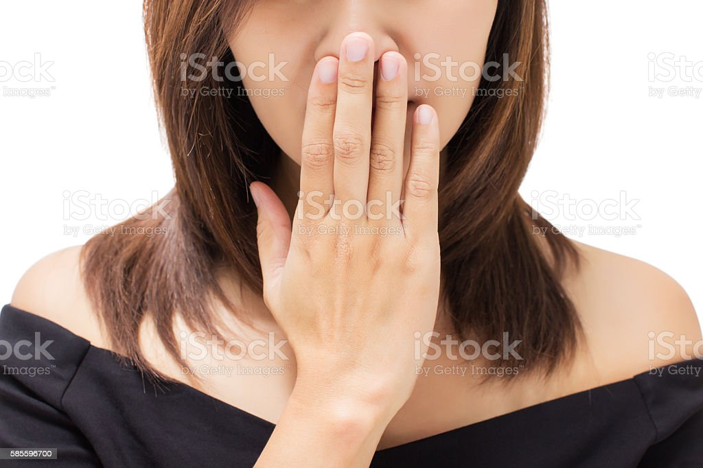 Scared young woman with her hand on her mouth stock photo