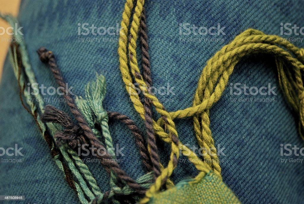 Scarf Strands Against Blue Pants stock photo