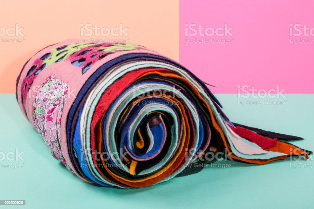 Scarfs of felted wool on a colored background stock photo
