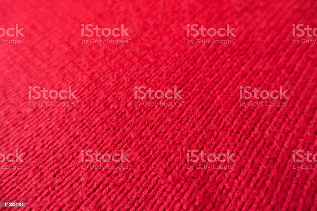 Scarlet red handmade fabric knitted by stocking stitch stock photo